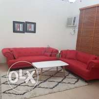 Beautifully furnished apartment with red sofa