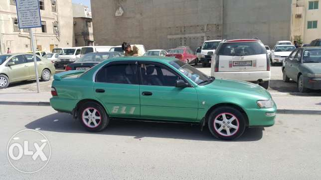 Toyota Corolla for sale or exchange need white colour only or silver