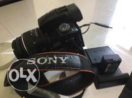 Sony A55 including 18-55 lens, camera bag, and original Sony tripod.