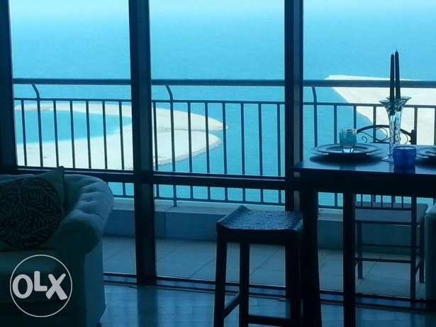 Sea view 1 bedrooms flat with balcony on higher floor in seef .