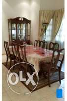 8 seater dining table with glass wardrobe for sale