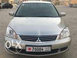 Urgent sale mitsubishi lancer 2013 second owner