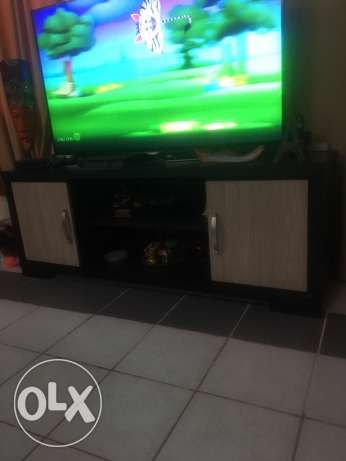 TV stand dining table and sofa come bed