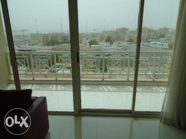 2 Bedrooms flat with big balcony at Umm Al Hassam