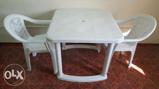 Plastic assembled table with 6 chairs راس رمان -  1