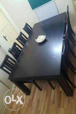 Dinning table for sale 8 chairs ..Quality Item