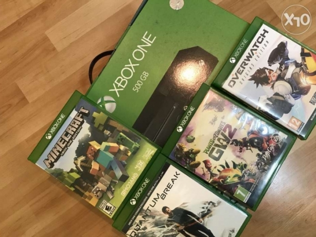 Xbox one with 4 games! Brand new condition