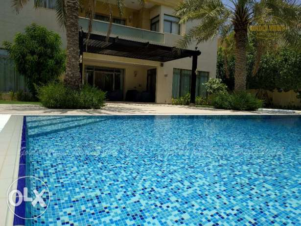 Modern luxury 5 BR semi furnished villa with pool close to Causeway