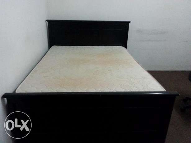 King size bed with one side table