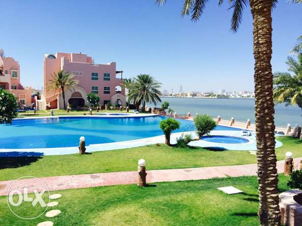 Four Bedrooms apartment in Tubli . Compound with Sea view .