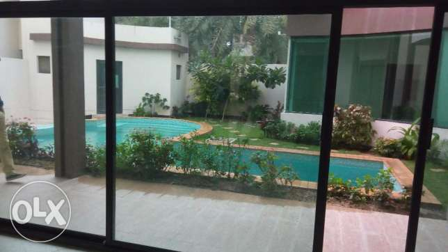 Spacious 4 BR Semi Furnished Villa with American Kitchen Saar Compound