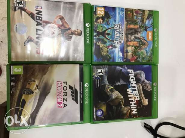 Xbox one in a very newly condition with four games