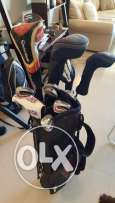 full set of golf clubs and an extra high value