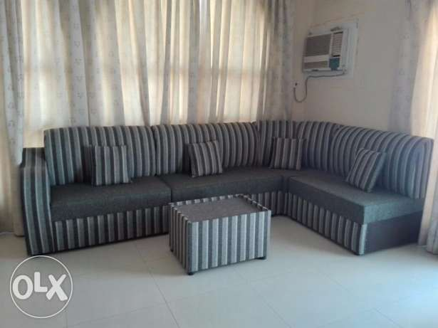 Brand new 7 seater sofa + centre table for sale.