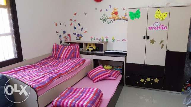 Kids bedroom with 2 sliding beds and 3doors wardrobe