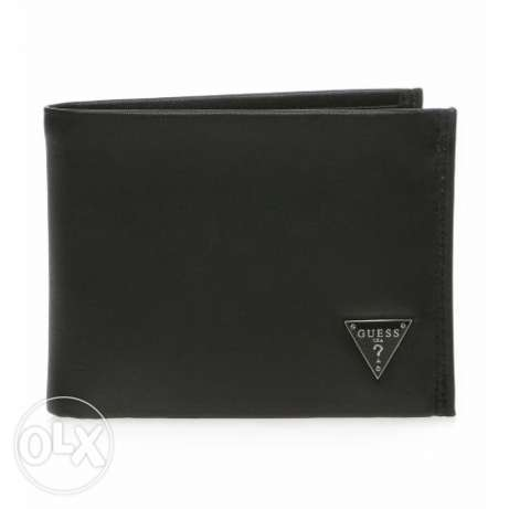 New Guess men wallet pure leather and authentic with unique design.
