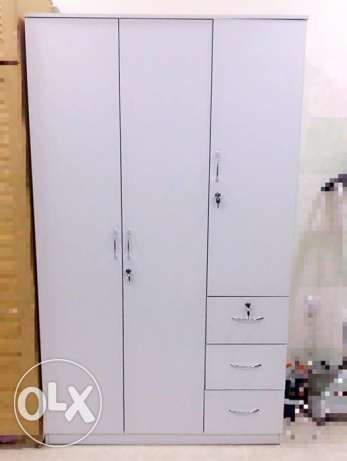 3 door white cupboard