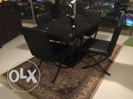 Black Glass table (heavy) with 6 leather chairs