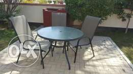 Garden table with 3 chairs and umbrella shade for only 15bd