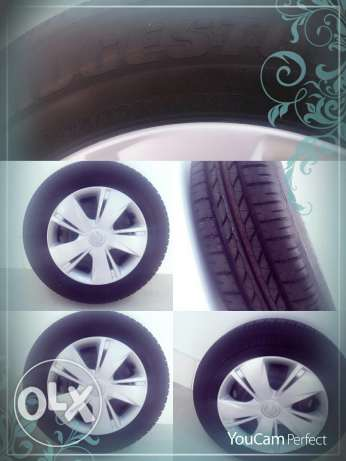 Tyre with wheel rim and cap urgent sale